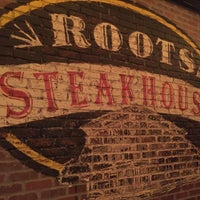 Photo taken at Roots Steakhouse by Matthew F. on 10/17/2016