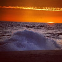 Photo taken at Huntington State Beach by Gabe R. on 9/1/2013
