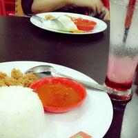 Photo taken at Pondok Bambu Food Court by Rima M. on 6/11/2014