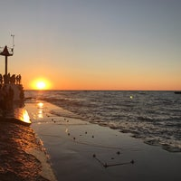 Photo taken at St. Joseph North Pier (at Tiscornia Park) by Emily W. on 7/30/2017
