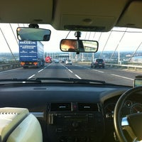 Photo taken at The Queen Elizabeth II Bridge by Caroline S. on 10/15/2012