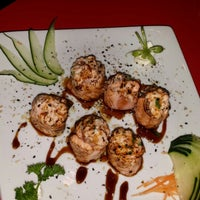 Photo taken at Sociedade do Sushi by Kika D. on 7/7/2014