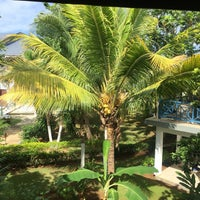 Photo taken at Negril Tree House Resort by M K. on 9/16/2016