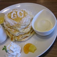 Photo taken at Cafe Gold Coast by emu o. on 10/30/2014