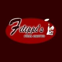 Photo taken at Filippi's Pizza Grotto by Yext Y. on 8/31/2017