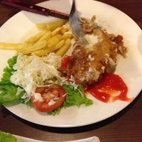 Photo taken at Solaria by Sherly T. on 6/9/2014