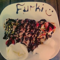 Photo taken at Atomik Waffle & Coffee by Furkan G. on 8/17/2014