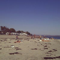 Photo taken at Централен Плаж Бургас (Burgas Central Beach) by Teodor S. on 9/23/2012