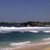 Photo taken at Pantai Indrayanti by Agung S. on 2/15/2013