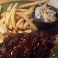 Photo taken at Applebee's Neighborhood Grill & Bar by Nicole S. on 8/1/2014
