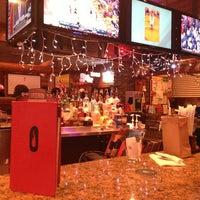 Photo taken at Smokey Bones Bar & Fire Grill by Michael B. on 1/5/2013