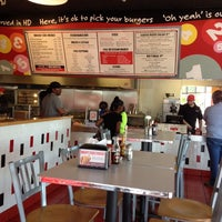 Photo taken at MOOYAH Burgers, Fries & Shakes by Smokinronnie H. on 4/18/2014
