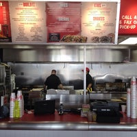 Photo taken at MOOYAH Burgers, Fries & Shakes by Smokinronnie H. on 10/22/2014