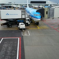 Photo taken at Gate D52 by Cetin Y. on 6/30/2014