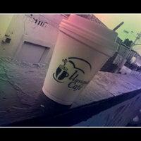 Photo taken at Lloviendo cafe by Regina M. on 8/9/2013