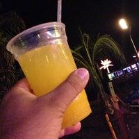 Photo taken at Martell's Tiki Bar by Lou C. on 7/9/2013