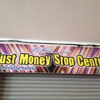 Photo taken at Just Money Stop Centre by Mohd Masrikin on 6/20/2014