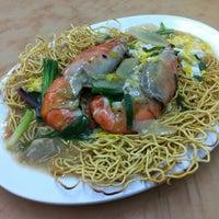 Photo taken at 同捞同煲小食店 by Jason K. on 12/23/2012