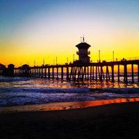Photo taken at Huntington Beach Pier by John D. on 7/25/2013