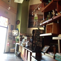 Photo taken at Eco Coffee House by Scott W. on 5/28/2014