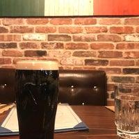 Photo taken at Passage Irish Bar & Kitchen by Jo  G. on 3/19/2017