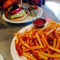Photo taken at Holy Cow by Ti on 12/2/2014