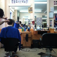 Photo taken at Astoria Barbers by Derrick Y. on 3/24/2012
