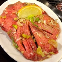 Photo taken at 炭火焼肉ギュービッグ by taq_n on 7/23/2014