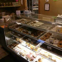 Photo taken at My Sister's Lil Donut Shoppe by Peter S. on 3/26/2013