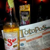 Photo taken at Totopos Gastronomia Mexicana by Fabiola T. on 5/21/2013