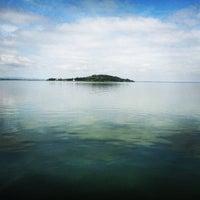 Photo taken at Lago Trasimeno by Infoturismiamoci on 6/2/2013