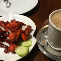 Photo taken at Kothur Indian Cuisine by Tyson S. on 12/31/2017