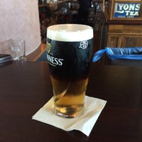 Photo taken at Tigín Irish Pub & Restaurant by Mark N. on 7/11/2015