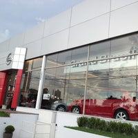 Photo taken at Nissan Grand Brasil by Luiz Alvaro S. on 12/20/2012