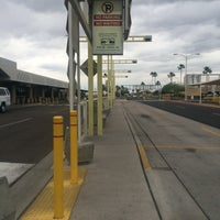 Photo taken at Rental Car Shuttle Stop Terminal 2 by Chris T. on 4/18/2014