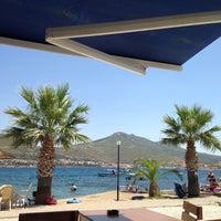 Photo taken at Çardak Cafe Plaj by Can H. on 7/11/2014