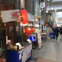 Photo taken at 十三東駅前商店街 by nongoro on 8/10/2017