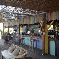 Photo taken at Pirata beach by Hasan S. on 6/24/2014