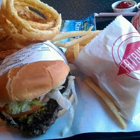 Photo taken at Fatburger by Angela C. on 4/8/2013