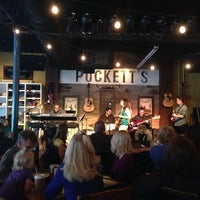 Photo taken at Puckett's Grocery & Restaurant by Steven L. on 4/14/2013