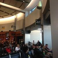 Photo taken at Gate 40 by Amanda S. on 3/14/2013