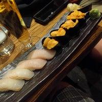 Photo taken at Kumi Japanese Restaurant + Bar by John C. on 6/26/2017