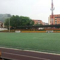 Photo taken at cancha del dorado by Giovanny B. on 10/7/2014