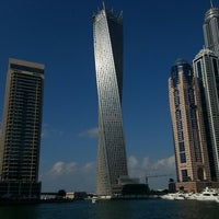 Photo taken at Dubai Marina Walk by Burak K. on 1/1/2013
