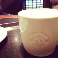 Photo taken at Starbucks by Inoue T. on 1/11/2013