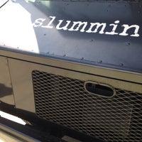Photo taken at Slummin' Gourmet Food Truck by Richard R. on 9/7/2014