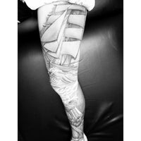 Photo taken at Hula Moon Tattoo Studio by Joshua R. on 8/18/2013