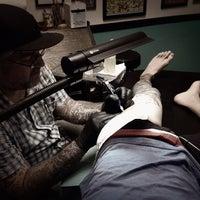 Photo taken at Hula Moon Tattoo Studio by Joshua R. on 7/6/2013