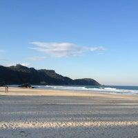 Photo taken at Praia do Mariscal by Leandro R. on 7/14/2013