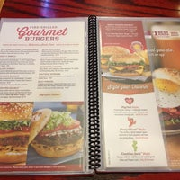 Photo taken at Red Robin Gourmet Burgers by C E. on 9/7/2013